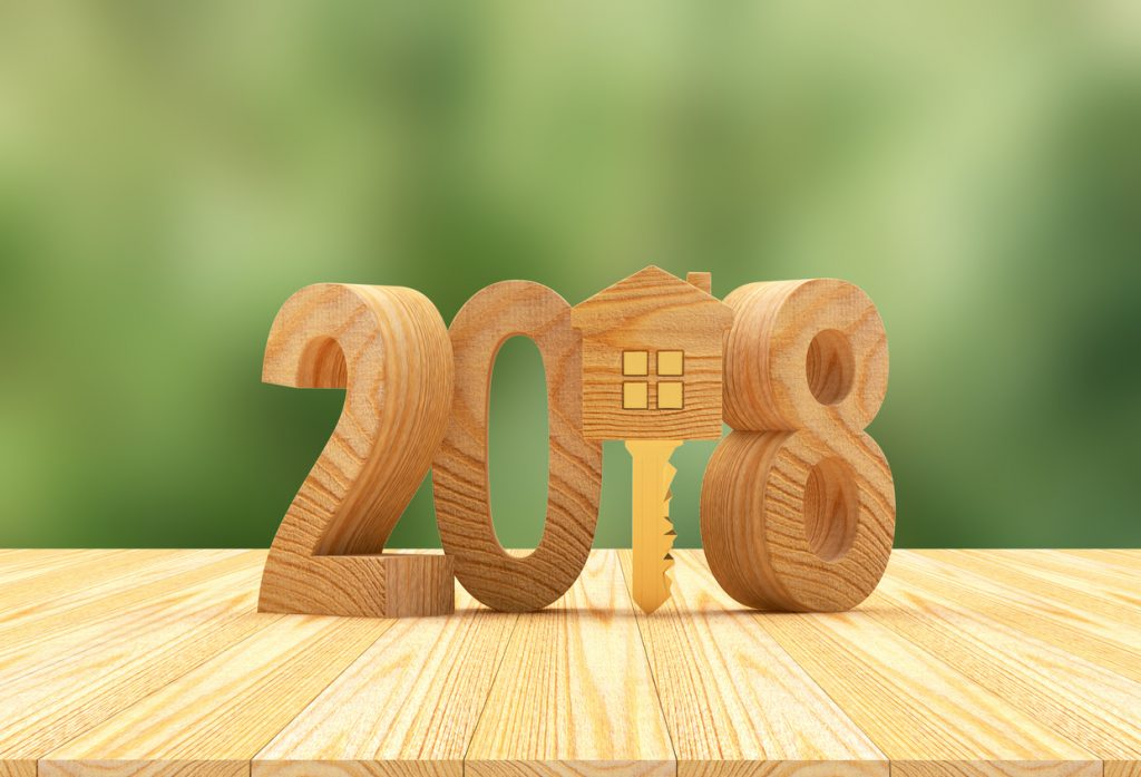 2018 and key-house icon on a green blurred background