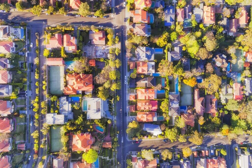 top down view of a neighborhood with houses