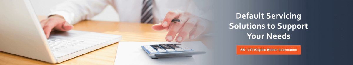 Stock image of a person working on laptop and calculating with calculator showing only hands