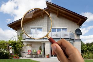 Person 039 S Hand Holding Magnifying Glass Over Luxury House